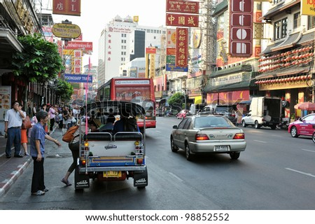 BANGKOK - MAR 2: Vehicles pass along Yaowarat Road in Chinatown on Mar 2, 2012 in Bangkok, Thailand. Yaowarat, the main street in Chinatown, was opened in 1891 in the reign of King Rama V.