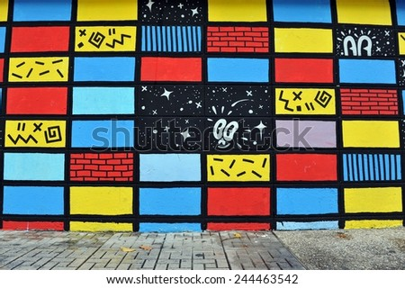 BANGKOK - MAR 15: View of street art by an unidentified artist on a city centre wall on Mar 15, 2013 in Bangkok, Thailand. The Thai capital is famous for its vibrant street art and graffiti scene. - stock photo
