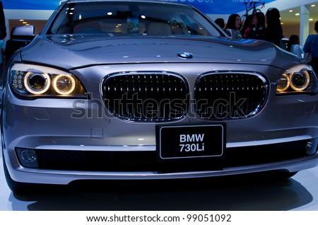BANGKOK - MARCH 31:  BMW 730i car on display at The 33th Bangkok International Motor Show on March 31, 2012 in Bangkok, Thailand. - stock photo