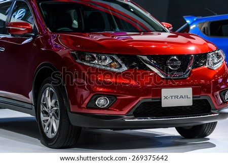 "BANGKOK - MARCH 24 : Nissan X-Trail on display at The 36th Bangkok International Motor Show ""Art of Auto"" on March 24, 2015 in Bangkok, Thailand. - stock photo"
