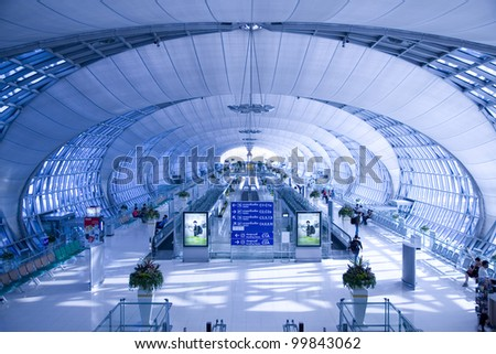 BANGKOK - MARCH 22 :The main concourse of Suvarnabhumi Airport, designed by Helmut Jahn is the world's third largest single-building airport terminal on March 22, 2012 in Bangkok, Thailand. - stock photo