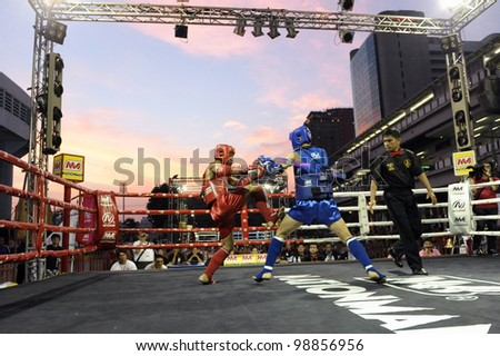 BANGKOK - MARCH 18: Unidentified Muay Thai fighters compete in the World Amateur Muay Thai Championships at the National Stadium on March 18, 2012 in Bangkok, Thailand. - stock photo