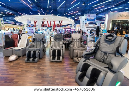 BANGKOK - MARCH 17, 2016: Vibrating massage armchairs for sale in the Siam Paragon Mall. It is one of the biggest shopping centers in Asia. - stock photo