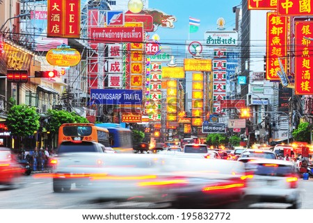 BANGKOK - MAY 27: Busy Yaowarat Road in the evening on MAY 27, 2014 in Bangkok. Yaowarat Road is a main street in Bangkok's Chinatown, it was opened in 1891 in the reign of King Rama V.  - stock photo