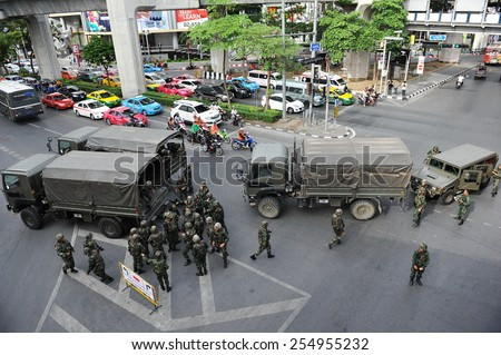 BANGKOK - MAY 30: Military deploy on a city centre street following a military coup on May 30, in Bangkok, Thailand. The Thai capital is under martial law after Thailand's 19th coup d'etat. - stock photo