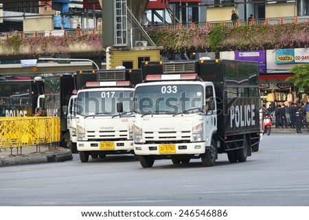 BANGKOK - MAY 30: Police vehicles deploy on a city centre street on May 30, in Bangkok, Thailand. Police and army soldiers sealed off streets to prevent a planned anti coup rally. - stock photo