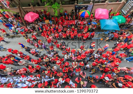 BANGKOK - MAY 19 : Rally supporters listening the speech, Ratchaprasong, Bangkok on May 19, 13. red-shirt supporters take part in the rally at Ratchaprasong in memory of the 2010 crackdown