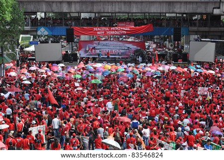 BANGKOK - MAY 19: Red-shirt protesters gather at Ratchaprasong Junction to mark one year since 91 people died in violent anti-government clashes in the Thai capital on May 19, 2011 in Bangkok, Thailand. - stock photo