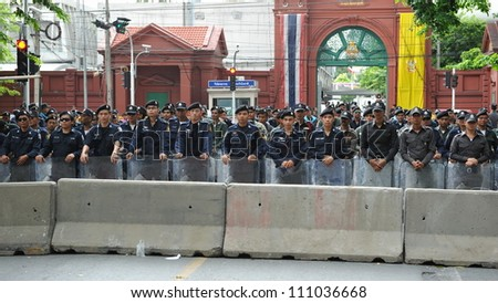 BANGKOK - MAY 31: Riot police form a line outside Thai Parliament during a political rally on May 31, 2012 in Bangkok, Thailand. Protesters rallied in opposition to a proposed reconciliation bill.