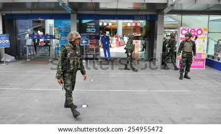 BANGKOK - MAY 30: Thai Army soldiers deploy on a city centre street following a military coup on May 30, in Bangkok, Thailand. The Thai capital is under martial law after Thailand's 19th coup d'etat. - stock photo