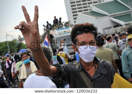 BANGKOK - NOV 24: A nationalist anti-government protester from Pitak Siam rallies at Makhawan Bridge on Nov 24, 2012 in Bangkok, Thailand. Pitak Siam are calling for the government to be overthrown.