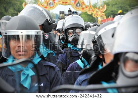 BANGKOK - NOV 24: A riot police officer stand guard during a city centre anti government rally on Nov 24, 2012 in Bangkok, Thailand. Police fired tear gas on several occassions to deter protesters. - stock photo