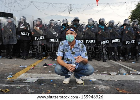 BANGKOK - NOV 24: An unidentified protester from the nationalist Pitak Siam joins an anti-government rally on Nov 24, 2012 in Bangkok, Thailand. Violent clashes with police erupted during the rally.  - stock photo