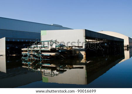 BANGKOK - NOV. 25: Factories damaged at Nava Nakorn Industrial, which is flooded for a period of 1 month on November 25, 2011 at Nava Nakorn Industrial Pathum Thani, in Bangkok.