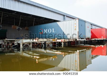 BANGKOK - NOV. 30: Factories damaged at Nava Nakorn Industrial, which is flooded for a period of 1 month on November 30, 2011 at Nava Nakorn Industrial Pathum Thani, in Bangkok.
