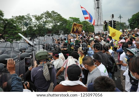 BANGKOK - NOV 24: Protesters from the nationalist Pitak Siam movement confront riot police during a violent anti-government rally on Nov 24, 2012 in Bangkok, Thailand. - stock photo