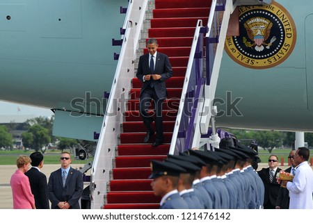 BANGKOK - NOV 18: US President Barack Obama arrives on Air Force One at Don Muang International Airport on day one of his three-nation Southeast Asia tour on November 18, 2012 in Bangkok, Thailand. - stock photo