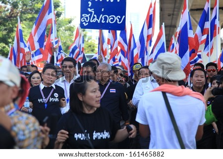 BANGKOK - NOVEMBER 4, 2013 : Anti-government protesters to the Democracy Monument on November 4, 2013 in Bangkok, Thailand. The protest Against The Amnesty bill in Bangkok, capital of Thailand