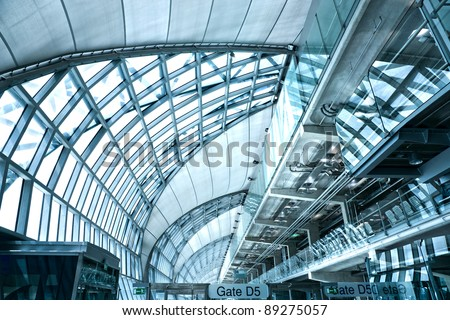 BANGKOK - NOVEMBER16: Futuristic interior of Suvarnabhumi airport on November 16, 2011 in Bangkok, Thailand. Airport is 18th busiest in the world (by passenger traffic),  was opened on Sept. 28, 2006 - stock photo