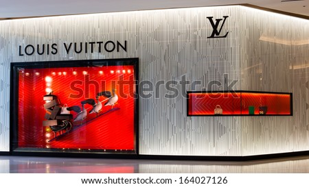 BANGKOK - NOVEMBER 19: Louis Vuitton store in Siam Paragon Mall  on Nov 19, 2013 in Bangkok, Thailand. Opened in July 2012, this is LV's 4th store in Bangkok. - stock photo