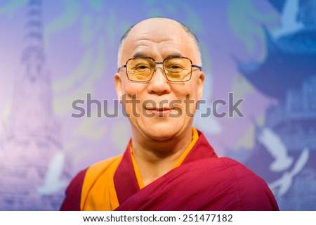 BANGKOK - OCT 21: A waxwork of Dalai Lama on display at Madame Tussauds on Oct 21, 2012 in Bangkok, Thailand. Madame Tussauds' newest branch hosts waxworks of numerous stars and celebrities. - stock photo