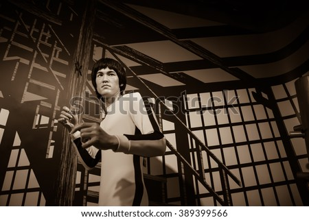 BANGKOK - OCTOBER 28: A waxwork of Bruce Lee on display at Madame Tussauds on October 28, 2015 in Bangkok, Thailand. Madame Tussauds' newest branch hosts waxworks of numerous stars and celebrities. - stock photo
