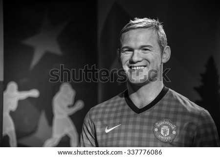 BANGKOK - OCTOBER 28: A waxwork of Wayne Rooney on display at Madame Tussauds on October 28, 2015 in Bangkok, Thailand. Madame Tussauds' newest branch hosts waxworks of numerous stars and celebrities. - stock photo