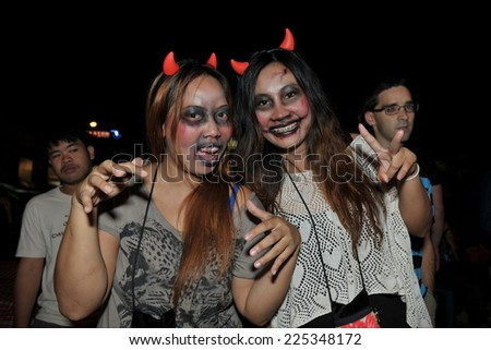 BANGKOK - OCTOBER 31: Unidentified revellers joins festivities on Khao San Road on October 31, 2012 in Bangkok, Thailand. The Khao San Halloween party is popular with locals and backpackers. - stock photo