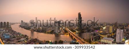 Bangkok panorama view at Dusk with modern business building along the Chao Phraya river (Thailand) - stock photo