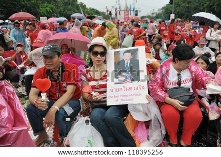 BANGKOK - SEPT 15: Red-shirt supporters rally at Democracy Monument to mark the 6th anniversary of a coup that ousted former prime minister Thaksin Shinawatra on Sept 15, 2012 in Bangkok, Thailand. - stock photo