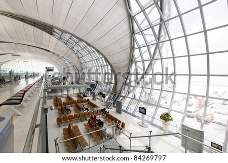 BANGKOK - SEPTEMBER 3 :The main concourse of Suvarnabhumi Airport , designed by Helmut Jahn is the world's third largest single-building airport terminal on September 3, 2011 in Bangkok ,Thailand. - stock photo