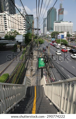BANGKOK, THAILAND - APRIL 17: A view of a main roadway from a pedestrian overhead bridge in the city of Bangkok, Thailand on the 17th April, 2015.