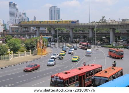 BANGKOK THAILAND - APRIL 19, 2015: Bangkok traffic and BTS train at Victory monument. Bangkok is famous for its heavy traffic congestion.  - stock photo