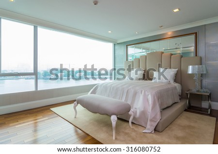 BANGKOK, THAILAND - APRIL 25 :  Luxury Interior bedroom which can river view at My resort as river condominium beside the chao phraya river on April 25, 2015 in Bangkok, Thailand - stock photo