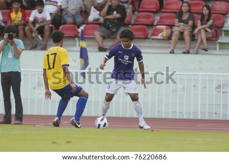 BANGKOK, THAILAND- APRIL 27: R.Pongputtra (R) in action during Thaicom  F.A.Cup between Bangkok Cristian fc  vs Tak Fc. on April 27, 2011 at  thebhussadin Stadium Bangkok, Thailand