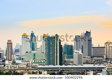 BANGKOK, THAILAND - 16 APRIL 2016 - Scene of Bangkok high-rise buildings and skytrain railroad in the evening light.