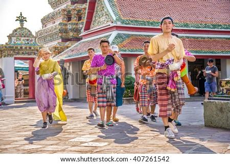 BANGKOK, THAILAND - APRIL 15, 2016: Songkran Festival, Unidentified people playing water at Wat Pho (Pho Temple) in Bangkok - stock photo