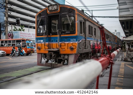 BANGKOK, THAILAND - APRIL 12, 2013: State Railway of Thailand's diesel car running through the streets of Bangkok, Thailand on 12 April 2013.