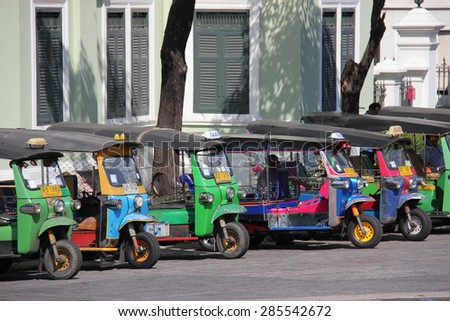 Bangkok, Thailand - April 21, 2015: The auto rickshaw, known as tuk-tuk, is a widely used form of urban transportation in Bangkok and other Thai cities. It is one of symbols of Thailand.