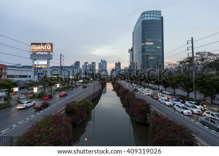 Bangkok,THAILAND, -18 APRIL 2016 : The View Nature in capital of canal and a tree Building in the distance on Naradhiwas Rajanagarindra Road Bangkok., Thailand