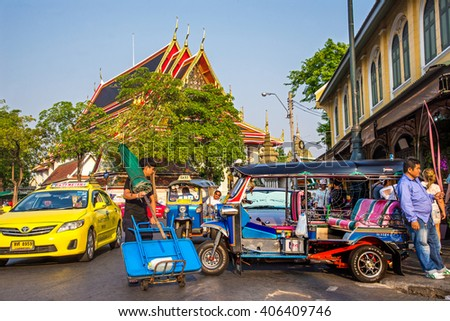 BANGKOK, THAILAND - APRIL 12, 2016 : Tricycle taxi of Thailand on street and background  of Wat Phra Chetuphon (locally known as Wat Pho). Here is destinations of landmarks traveler. - stock photo