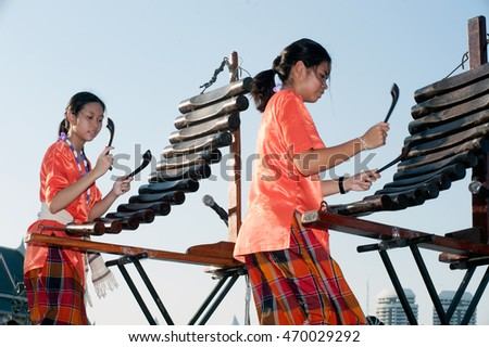 BANGKOK,THAILAND-APRIL 20,2015:Unidentified people of Thai music band playing Pong Lang traditional instrument during festival on The 233 rd Year of Rattanakosin City.The show is open free for public.
