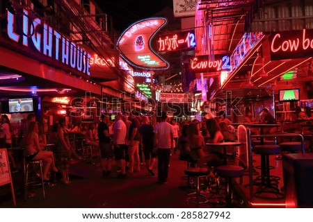 BANGKOK THAILAND - APRIL 20, 2015: Unidentified people visit Soy Cowboy. Soy Cowboy is a 150 meter long street with some 40, mostly go-go bars in Bangkok which is similar to Nana Plaza.  - stock photo
