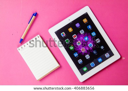 BANGKOK,THAILAND - Aprill 18,2016: Social media icons on screen of iPad and iPhone. Social media are most popular tool for communication, sharing information and content between people in internet. - stock photo