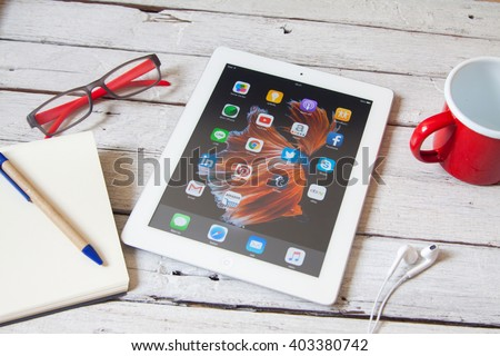 BANGKOK,THAILAND - Aprill 8,2016: Social media icons on screen of iPad and iPhone. Social media are most popular tool for communication, sharing information and content between people in internet. - stock photo