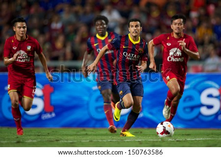 BANGKOK,THAILAND-AU GUST07:Pedro Rodrguez (R2) of FC Barcelona in action during the international friendly match Thailand XI and FC Barcelona at Rajamangala Stadium on August 7,2013 in,Thailand. - stock photo