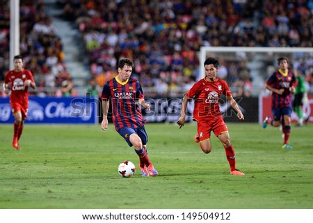 BANGKOK,THAILAND-Aug 7:Lionel Messi(L) of FC barcelona in action during football friendly match between Thailand national team vs FC barcelona at Rajamangala stadium on Aug 7,2013 in,Thailand  - stock photo