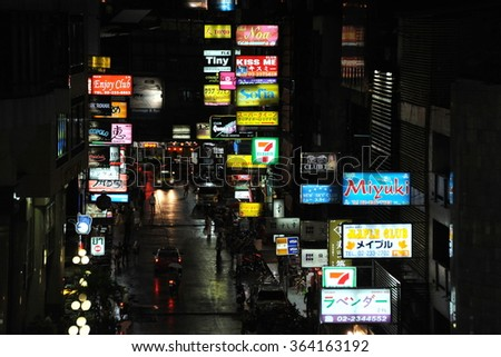 BANGKOK THAILAND - AUG 17, 2013: Nighttime view of hostess clubs on Soi Thaniya in Patpong's red light district. Known as Little Tokyo Soi Thaniya is famous for its Japanese oriented nightlife.