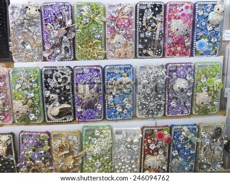 BANGKOK, THAILAND - AUG 11: Phone cases being sold at a mall in Bangkok, Thailand, as seen on Aug 11, 2012. - stock photo