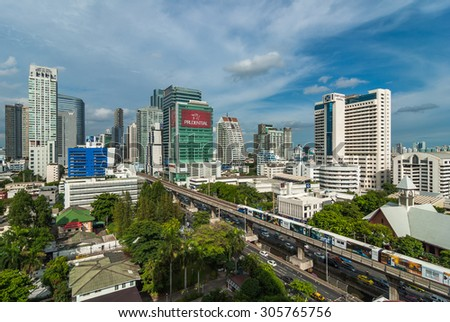 BANGKOK, THAILAND - AUG 6 : Sky train running and traffic jam with beautiful cloud and sky on cityscape background on August 6, 2015 in Bangkok, Thailand